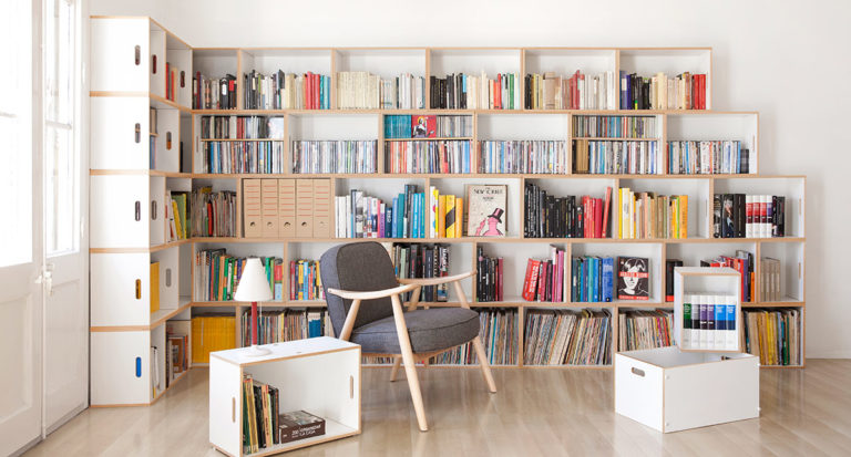 white modular boxes stacked into bookshelf