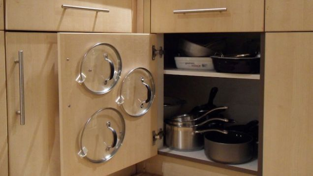 Pots stored on a cabinet door using 3M strips and hooks