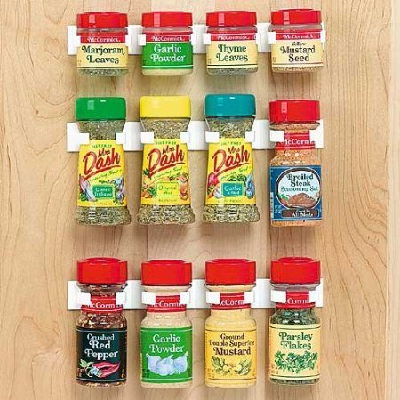 Assorted spices hung on door using 3M strips