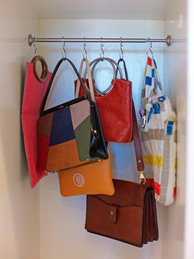 Handbags hung on a tension rod using S hooks