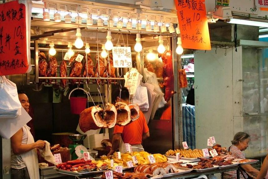 Roast duck and BBQ pork hung by S hooks in Kowloon