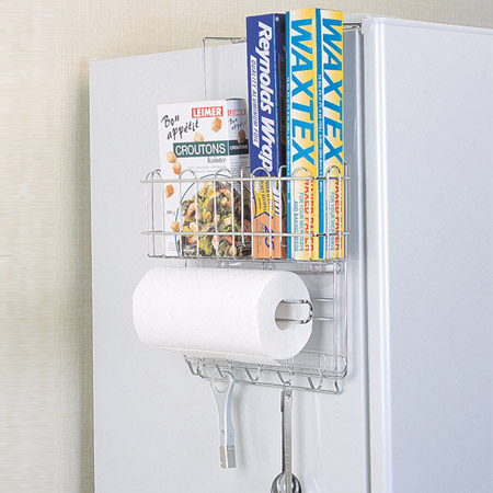 Wire rack on the side of a fridge to store paper towels
