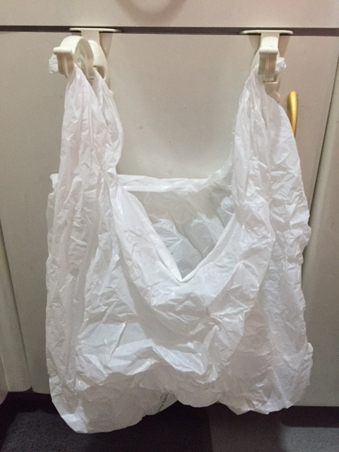 Plastic bag holder with plastic bag