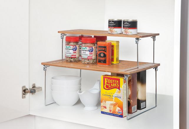 Bamboo stackable shelves holding spices