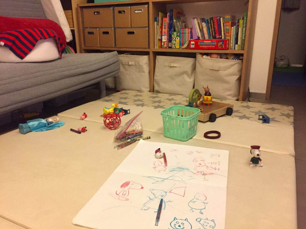 Toys and sketch book on playing mat