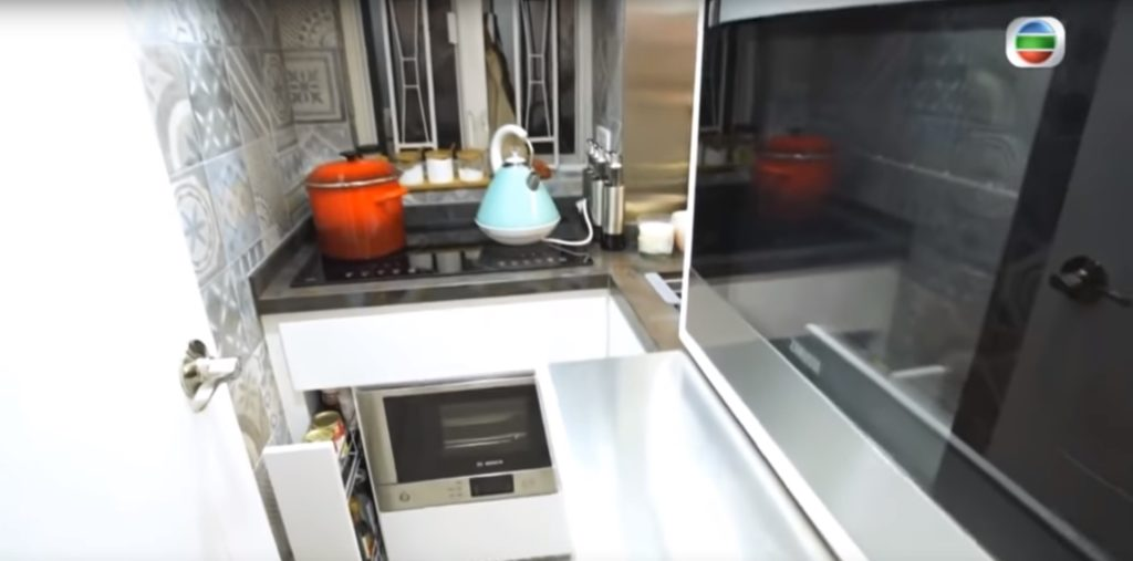 Hidden pantry and stainless steel work surface in small kitchen