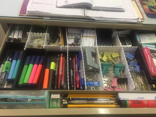 Organized stationary in desk drawer at work
